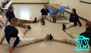 Summer Interns spend quality time with an African Penguin